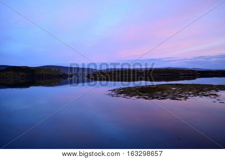 Serene loch dunvegan at twilight in Scotland.