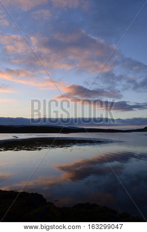 Pretty clouds reflecting in Loch Dunvegan in Scotland.