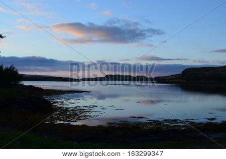 Calm loch waters off of the coast of Dunvegan Scotland.
