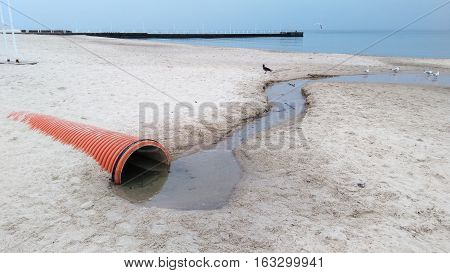 Water Coming Out Of Tube to the Sea