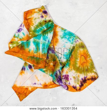 Crumpled Hand Painted Scarf On Concrete Plate