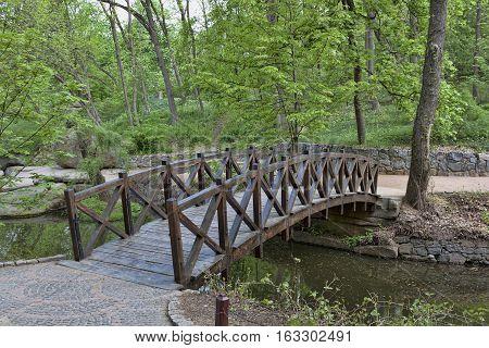 Wood bridge in Sofiyivsky Park. Northern part of the Uman city Cherkasy Oblast Ukraine.