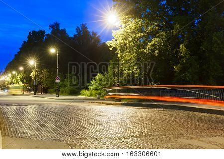 cast iron bridge on Penkovy bridge through a bypass channel at night in Kronstadt. Saint-Petersburg, Russia