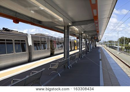 KIPPA RING, AUSTRALIA - December 28, 2016: View of the platforms and train on the new railway station of Kippa Ring in the Redcliffe Peninsula Line Australia