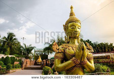 Golden StuccoThai Traditional Art Angel (Lai Thai) Handmade with Blue Sky Background Wallpaper