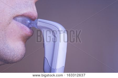 Vibrator for dental braces inside the mouth of a man