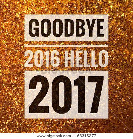 Goodbye 2016 hello 2017 words on shiny gold glitter background