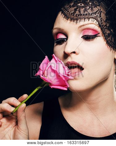 portrait of beauty young woman through lace close up mistery makeup on black background