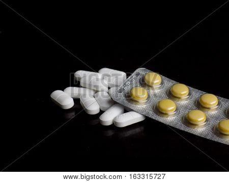 Medical pills on black background, medical drugs