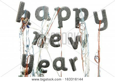 Happy new year written in silver glitter party text with party popper streamers. Studio set against a bright white background. For greeting card, invitation or header etc.