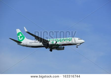 Amsterdam the Netherlands - July 21st 2016: PH-HXA Transavia Boeing 737 approaching Polderbaan runway at Schiphol Amsterdam Airport arriving from Faro Portugal