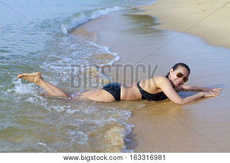 Lady enjoy pretty swimsuit in Ban Krut Beach at Prachuap Khirikhun Province Thailand