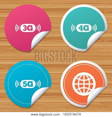 Round stickers or website banners. Mobile telecommunications icons. 3G, 4G and 5G technology symbols. World globe sign. Circle badges with bended corner. Vector