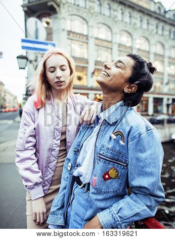 cute young couple of teenagers girlfriends having fun, traveling europe, modern fashion citylife, lifestyle people concept close up