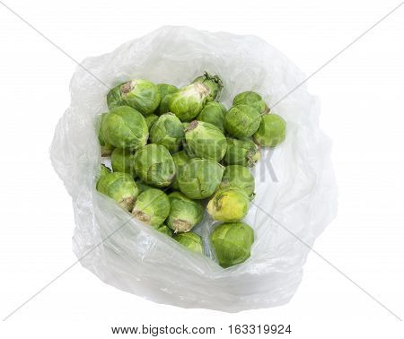Open plastic bag with Brussels sprouts on a white background