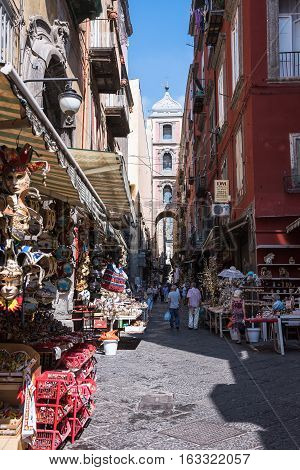Naples Italy - August 30 2016: Tourists visit narrow street of Gregorio Armeno with many souvenir shops