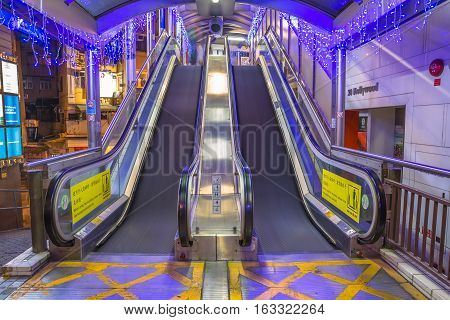 Hong Kong, China - December 10, 2016: the Central-Mid-Levels escalator, the longest outdoor covered escalator system in the world, in Hollywood road, Soho district, Central Hong Kong, by night.