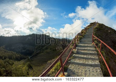 Path to Viewpoint in Caldera of Kelimutu Volcano and view to the Black Lake by the left side Flores Indonesia