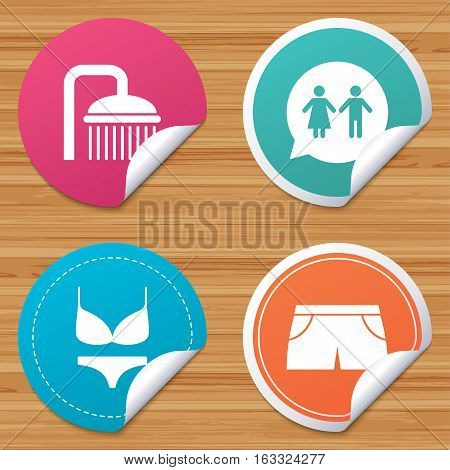 Round stickers or website banners. Swimming pool icons. Shower water drops and swimwear symbols. WC Toilet speech bubble sign. Trunks and women underwear. Circle badges with bended corner. Vector