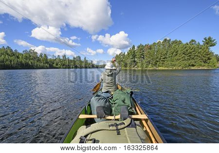 Paddling on a Burke Lake in the Wilderness of Quetico Provincial Park in Ontario