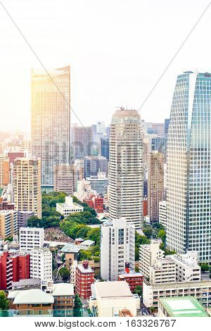 Asia Business concept for real estate and corporate construction - vertical modern cityscape building bird eye aerial view from tokyo tower under sunrise and morning blue bright sky in Tokyo Japan