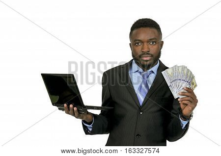 Handsome man with cash using a computer