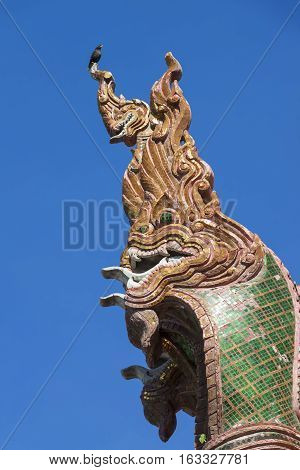 Naga sculpture on the roof of the temple