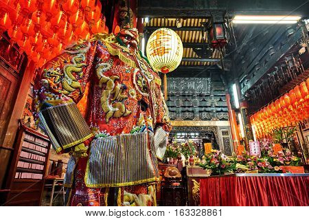 Xiluo, Taiwan - Mar. 12 : God statue in traditional old oriental chinese temple in Taiwan (Chinese Translation on lantern : name of the chinese god of sea mazu(matsu)) at Mar. 12, 2016