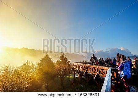 Alishan, Taiwan - 26 May : Beautiful morning sunrise dramatic cloud of sea and Yushan mounatin under bright blue sky in Alishan(Ali mountain) National Park Taiwan at 26 May, 2016