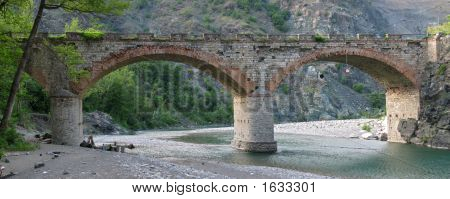 Old bridge on river Trebbia Italy view. poster