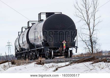 Black Railway Tank Cars Curving Around a Corner