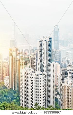Business concept for real estate and corporate construction - panoramic modern city skyline bird eye aerial view with dramatic sunrise and morning blue sky in Hong Kong (HK) China