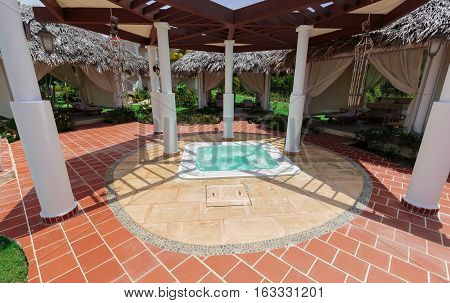 amazing nice view of a small Jacuzzi with sea water at spa area in tropical garden on sunny warm day
