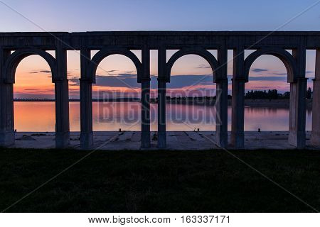 Sunset over the city lake in Bucharest. Port on Morii Lake Island