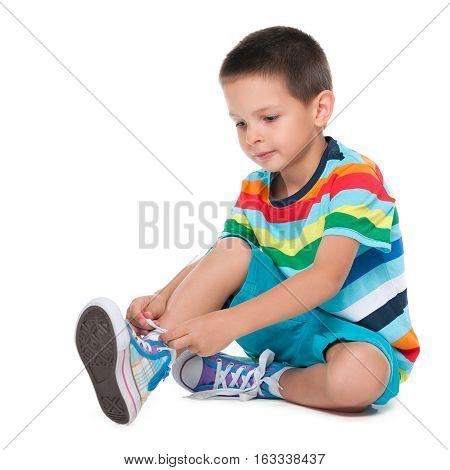 Cute Boy Tying Shoelaces