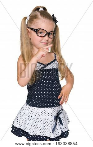 Little Girl Shows Her Forefinger To The Side