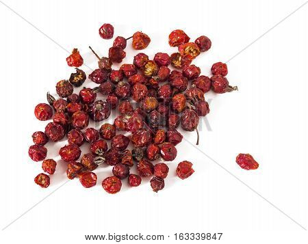 Dry rosehips berries isolated on white background