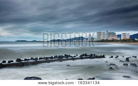 A slow exposure of a cloudy morning sky over Nha Trang bay Vietnam.