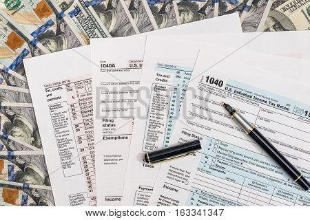 1040 tax form on 100 us money