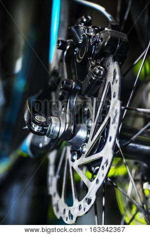 Close view of bicycle front wheel disk brakes