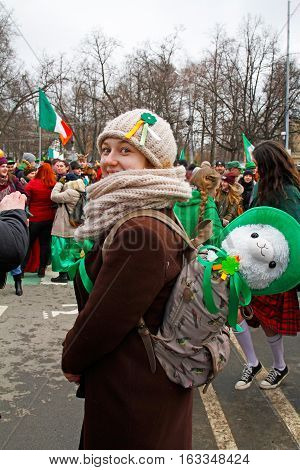 Moscow Russia - March 19 2016: Participant with the sheep toy at the St. Patrick's Day Parade in the park Sokolniki in Moscow