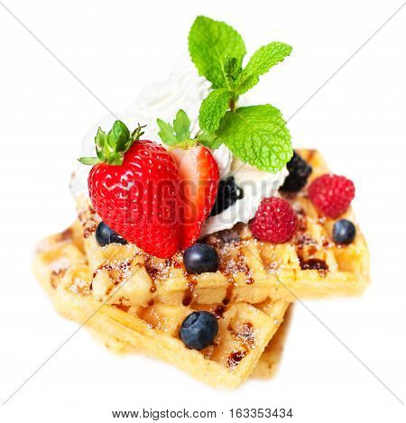Belgian waffles with fresh berries isolated on white background