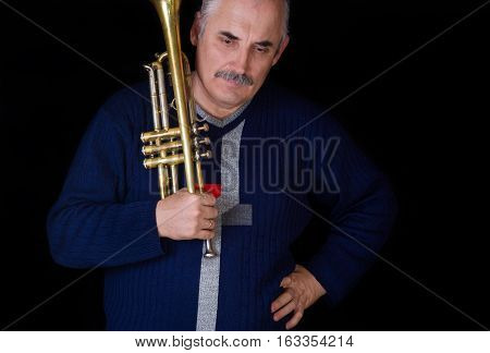 Portrait of mature trumpeter meditating on musical composition.