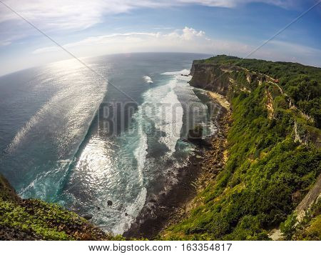 Wide Beautiful view of Cliff Sea Wave and Sunny with Blue Sky at Bali Island Indonesia