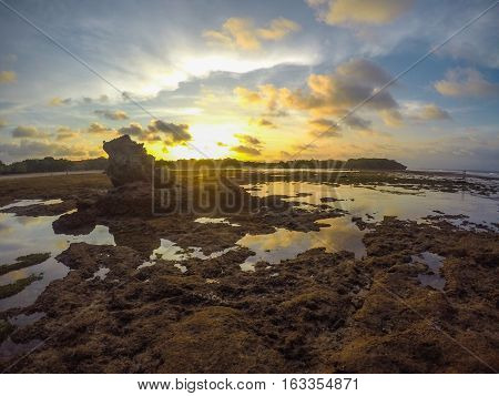 Wide Beautiful View of Sunset at the Beach. People Famous to Vacation in Holiday at Bali Indonesia