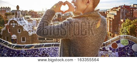 Tourist Woman In Barcelona, Spain Showing Heart Shaped Hands
