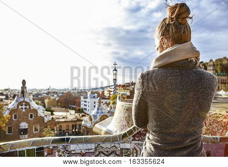 Trendy Woman In Coat At Guell Park In Barcelona, Spain