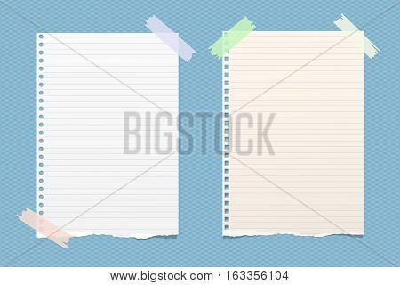 White ruled note, notebook, copybook paper sheets stuck with sticky tape on blue squared pattern.