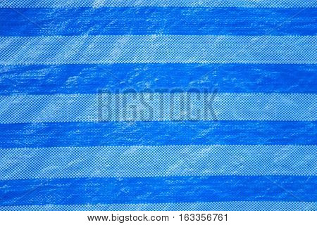 Blue polyester fabric or plastic texture background.