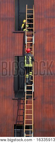 Fireman Climbs Up The Ladder During A Training Exercise
